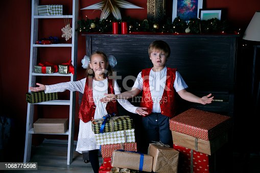 865399512 istock photo Boy and girl in new year 1068775598