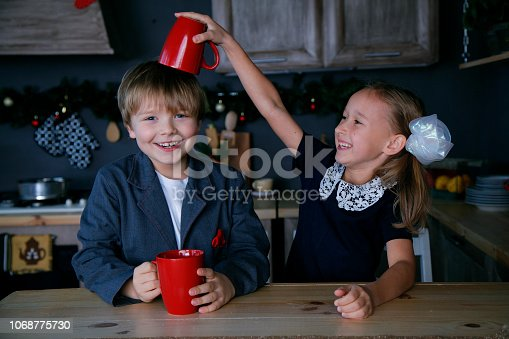 865399512 istock photo Boy and girl in new year 1068775730