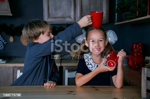 865399512 istock photo Boy and girl in new year 1068775796