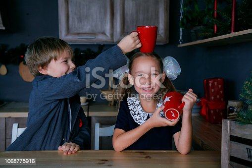 865399512 istock photo Boy and girl in new year 1068775916