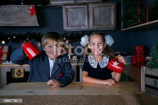 865399512 istock photo Boy and girl in new year 1068776012