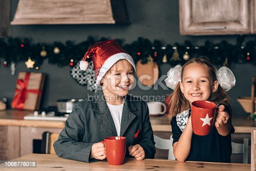 865399512 istock photo Boy and girl in new year 1068776018