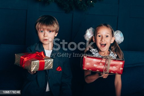 865399512 istock photo Boy and girl in new year 1068776246