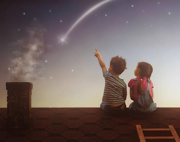 Boy and girl make a wish stock photo