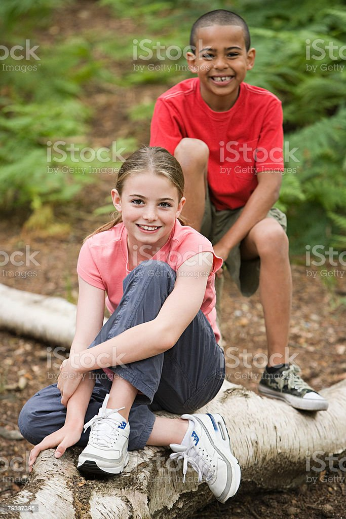 Boy and girl on log royalty-free 스톡 사진