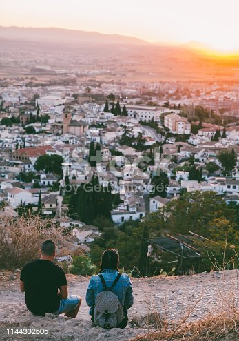Boy and girl on mountain in Granada,Spain.