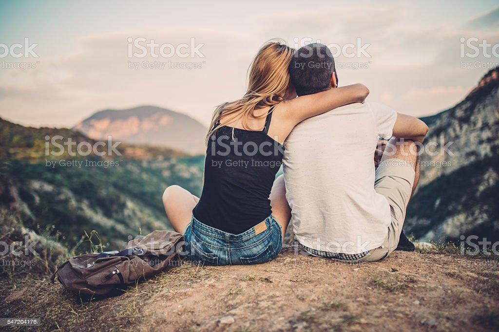 Boy and girl on mountain stock photo