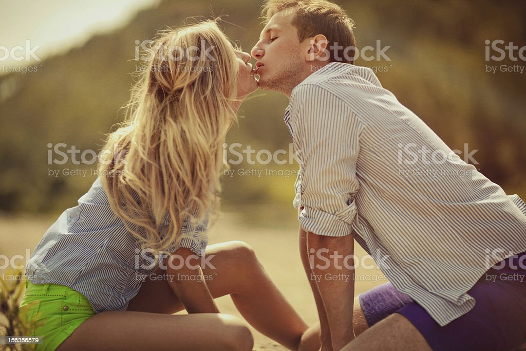 boy and girl on the beach royalty-free stock photo