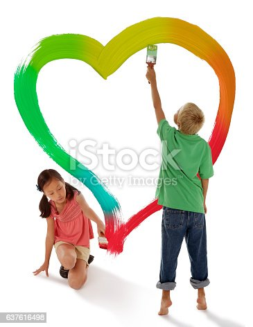 123500924 istock photo Boy and Girl Painting a Rainbow Heart 637616498