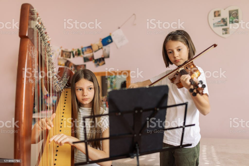 Boy and girl playing music at home - Royalty-free 10-11 Years Stock Photo