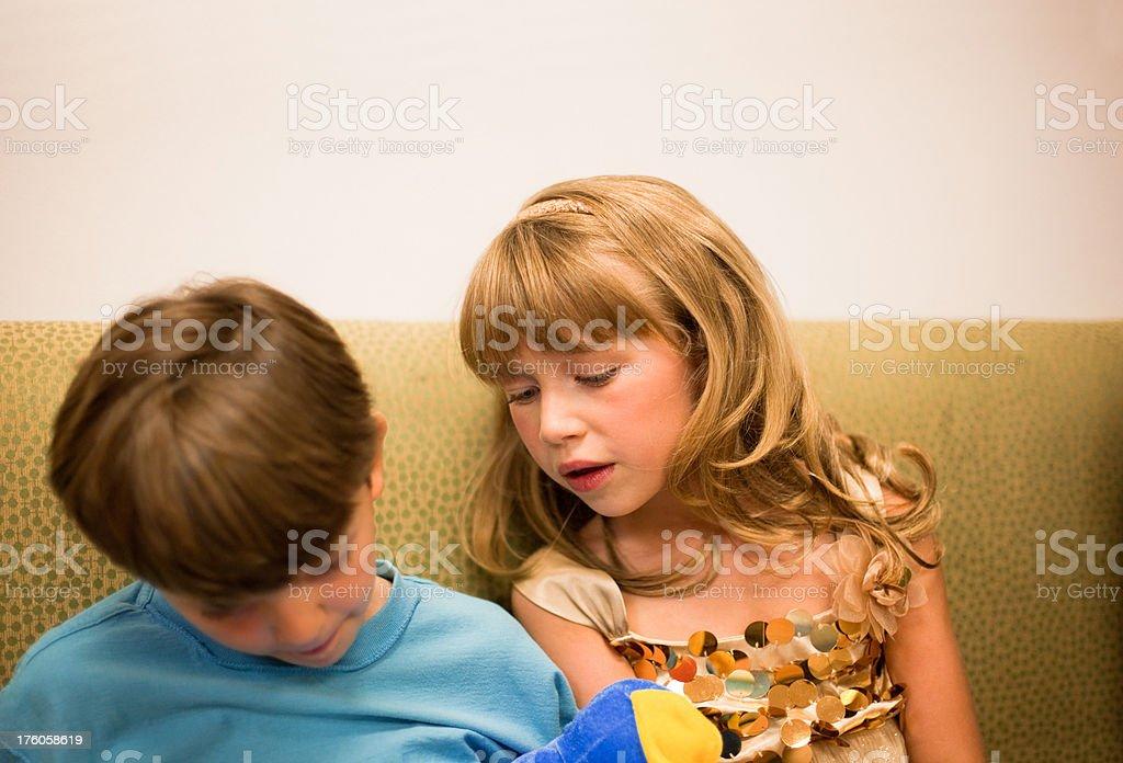 Boy and Girl Playing Portable Game stock photo