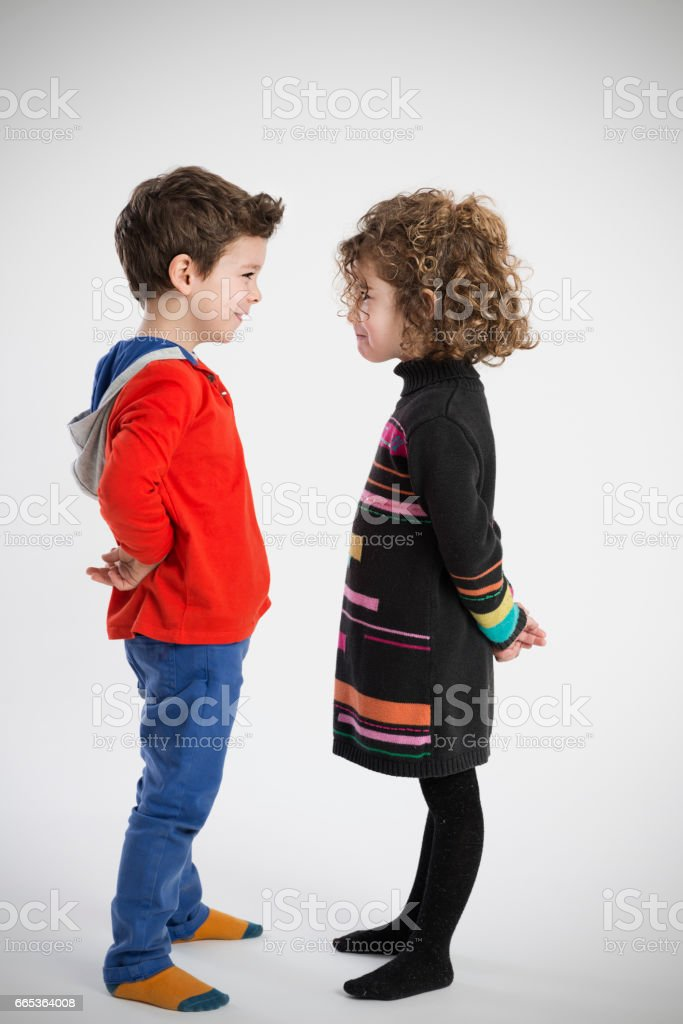 boy and girl, portrait in the studio stock photo