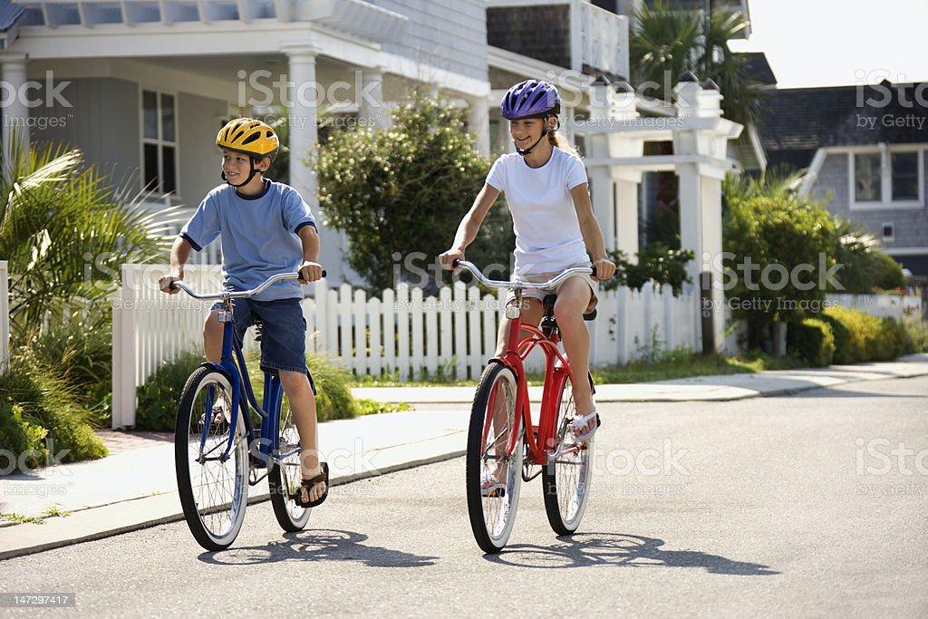 Boy and Girl Riding Bikes stock photo
