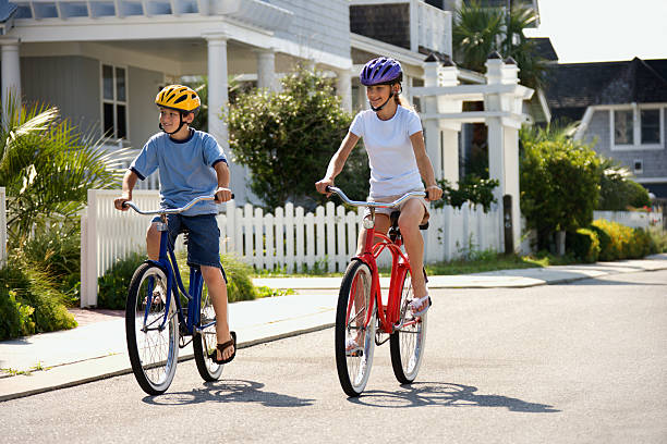 Boy and Girl Riding Bikes stock photo