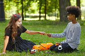 istock Boy and Girl Sharing Candy on Halloween 1274885513
