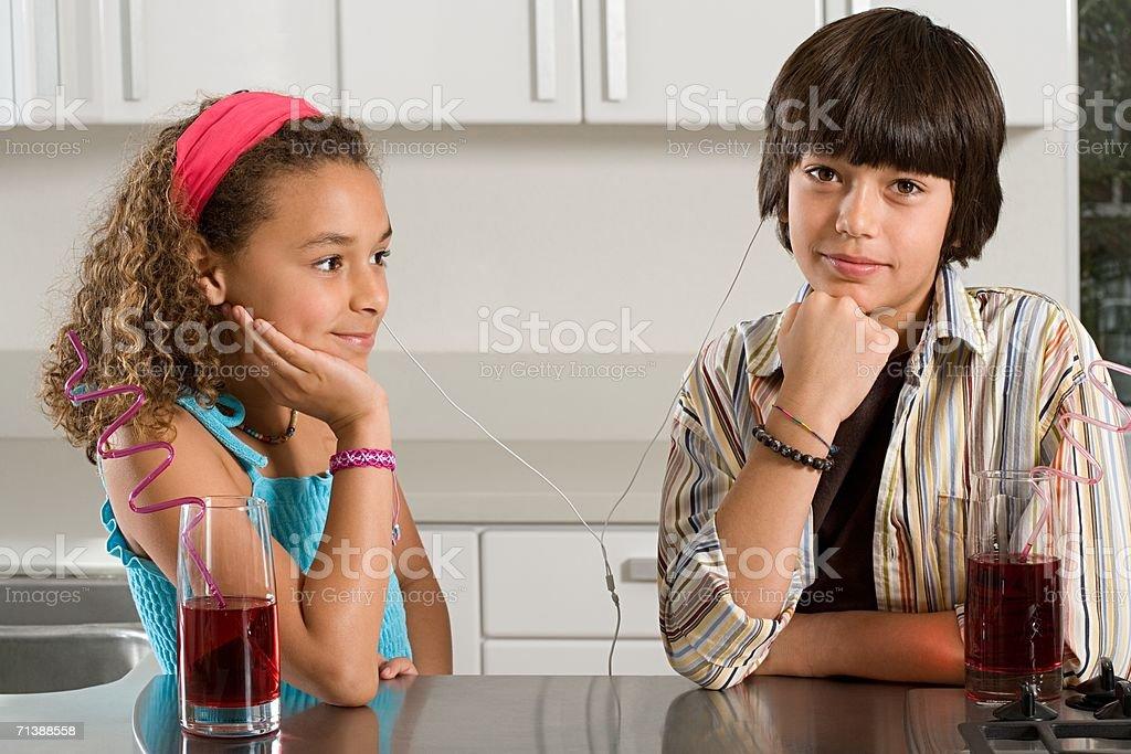 Boy and girl sharing headphones royalty-free stock photo