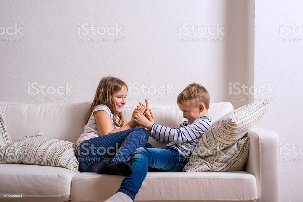 Wondrous Boy And Girl Sitting On White Couch Copy Space Stock Photo Squirreltailoven Fun Painted Chair Ideas Images Squirreltailovenorg