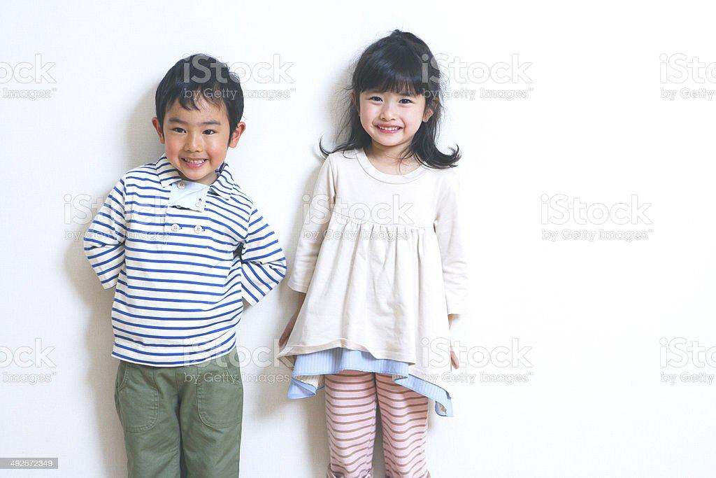 少年と少女の笑顔も ストックフォト