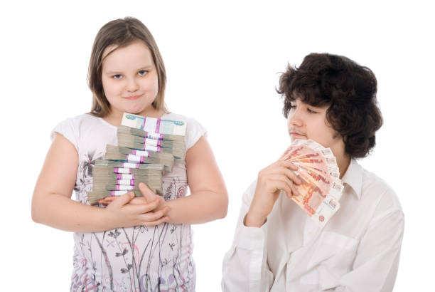 boy and girl with money stock photo