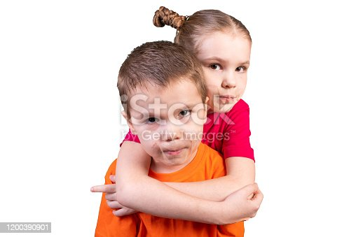 istock Boy and girl with mouths sealed. Isolated on a white background. 1200390901