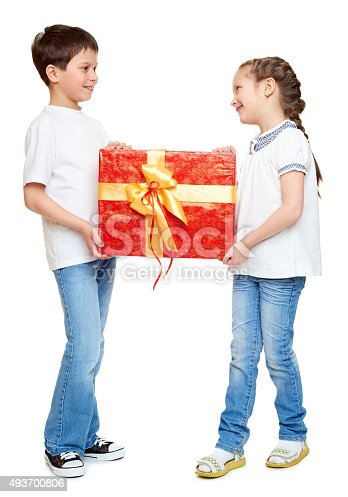 istock boy and girl with red gift box and golden bow 493700806