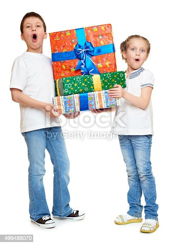 istock boy and girl with red gift box and golden bow 499489070