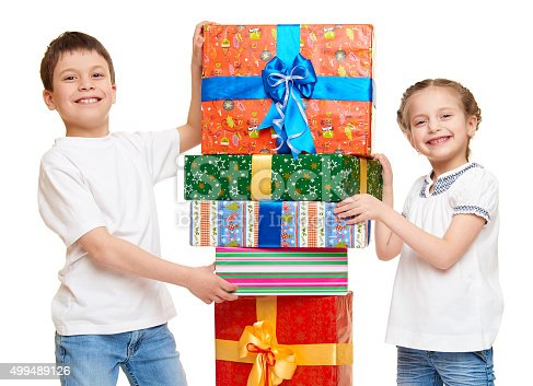 istock boy and girl with red gift box and golden bow 499489126