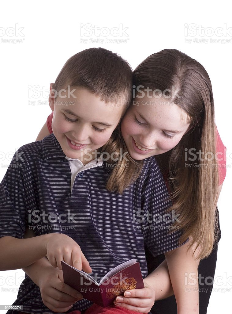 Boy and Girl with UK passport royalty-free stock photo