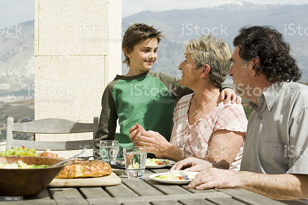 Boy and grandparents at meal royalty-free stock photo