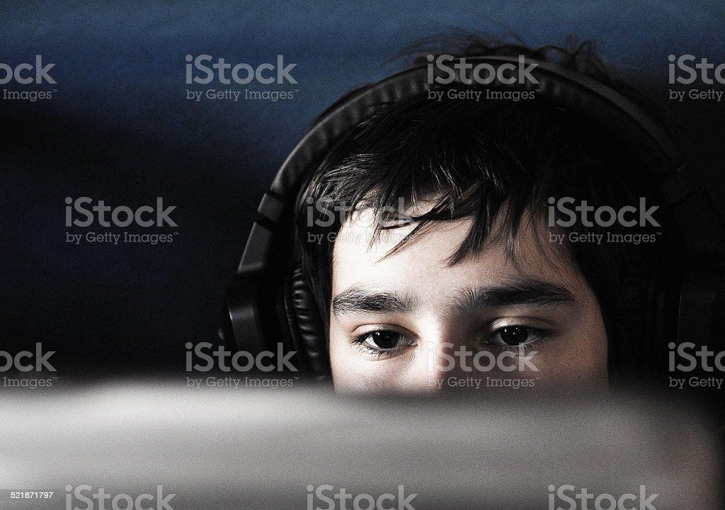 boy and headphones stock photo
