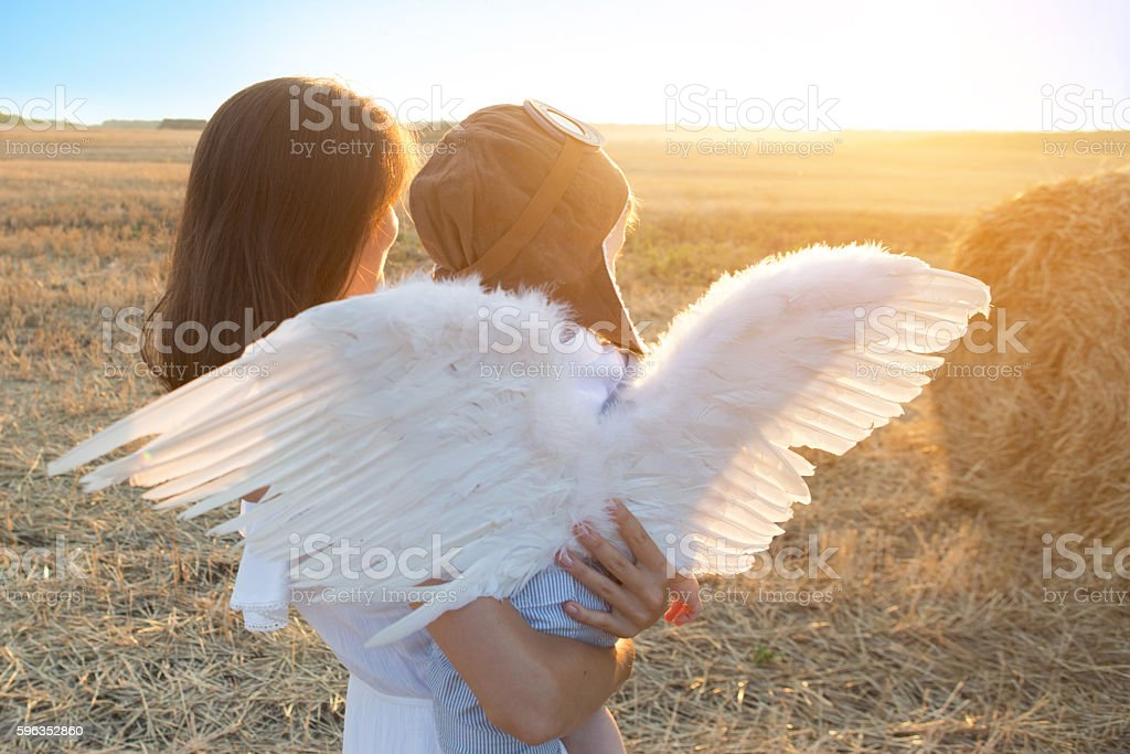 Boy and his mother playing the aviator. royalty-free stock photo