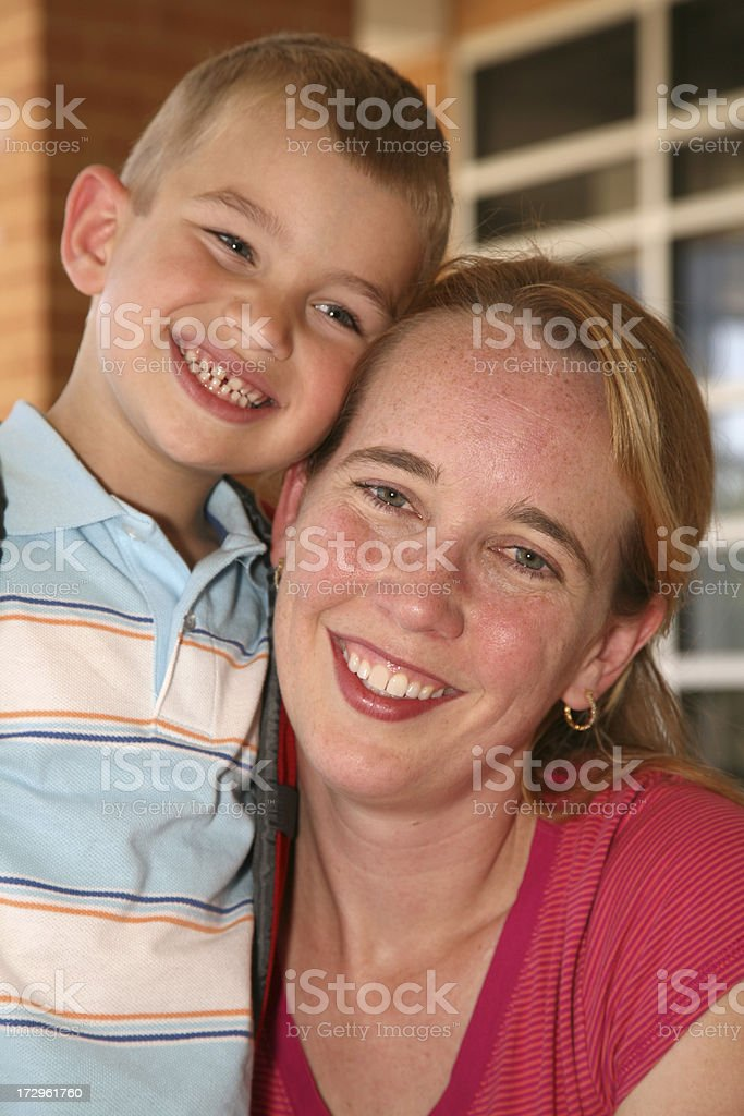 A boy and his mother smile in this porch headshot. royalty-free stock photo