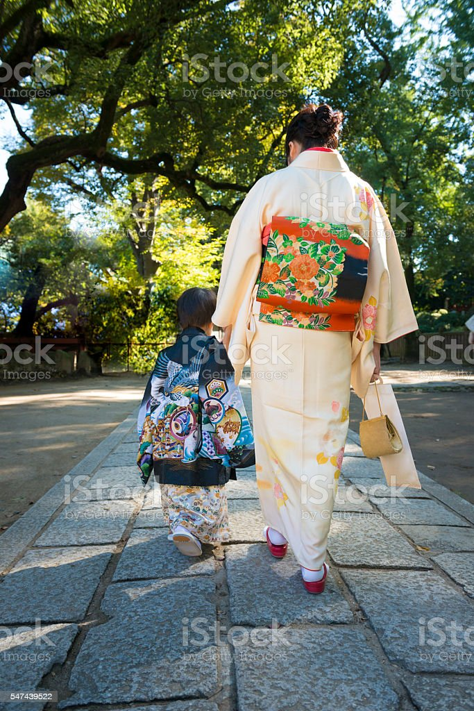 Boy and his mother wearing traditional costume. stock photo