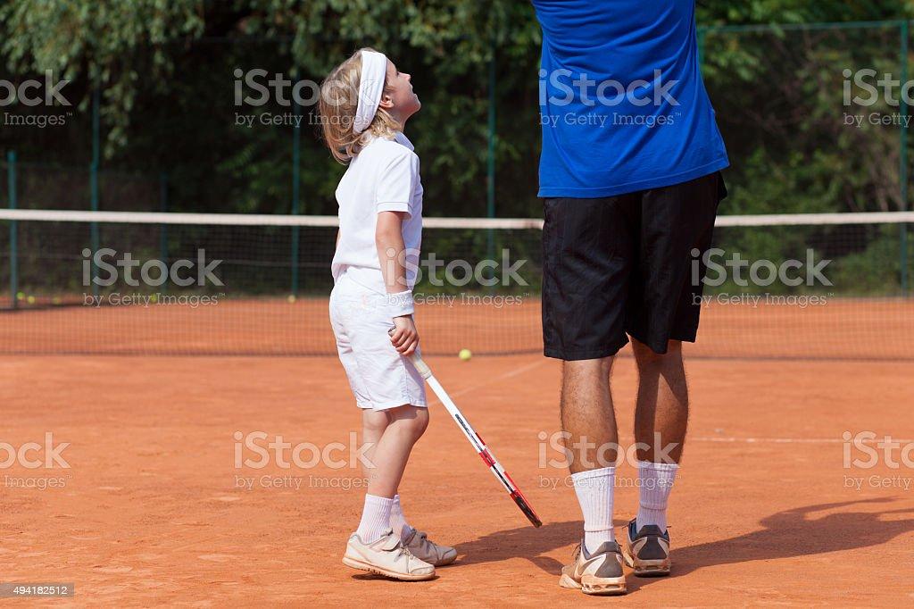 boy and his tennis coach stock photo