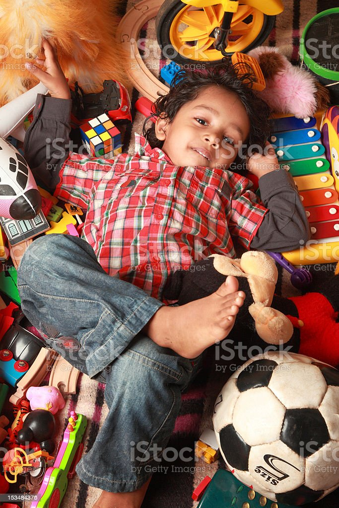 Boy and his toys royalty-free stock photo