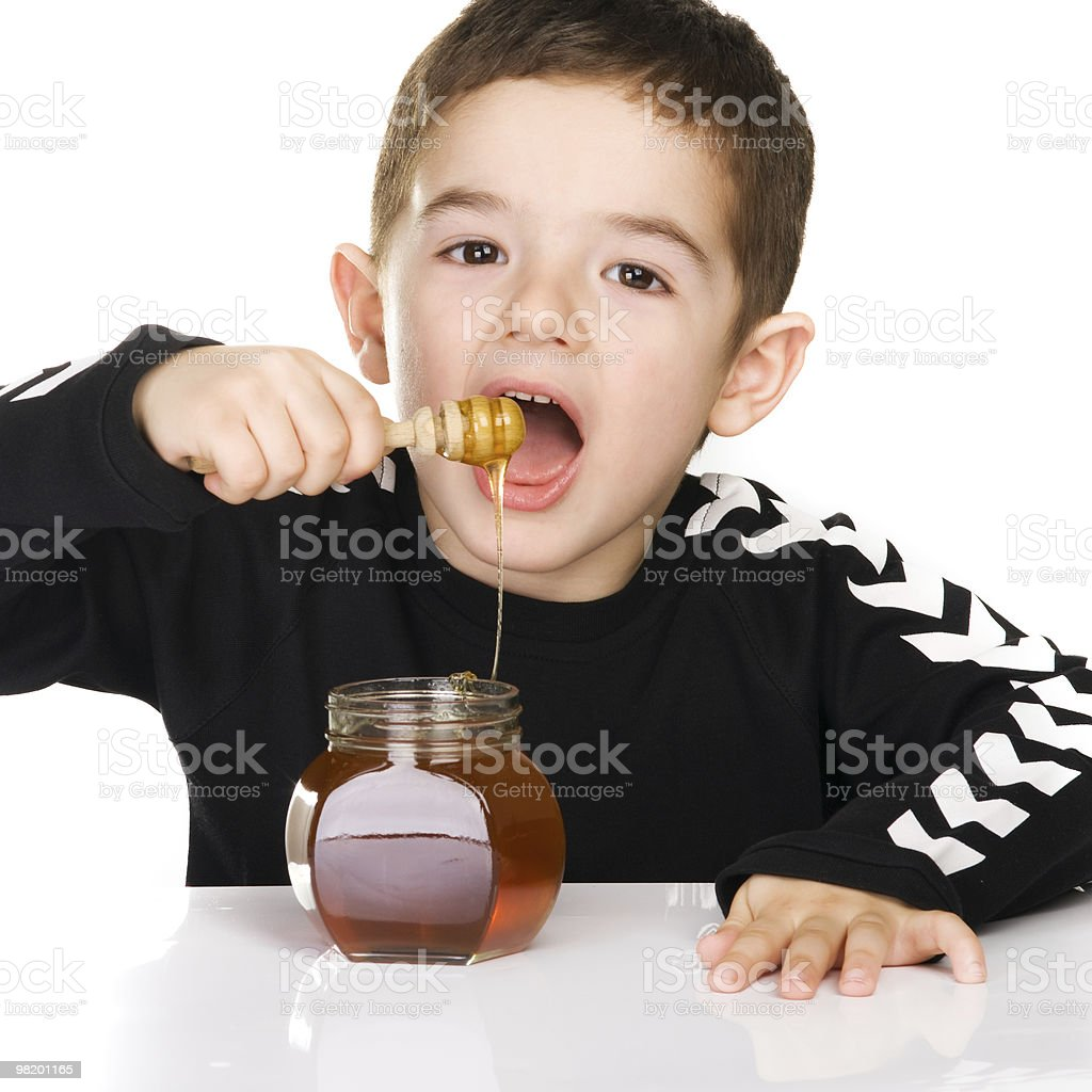 Boy and Honey royalty-free stock photo