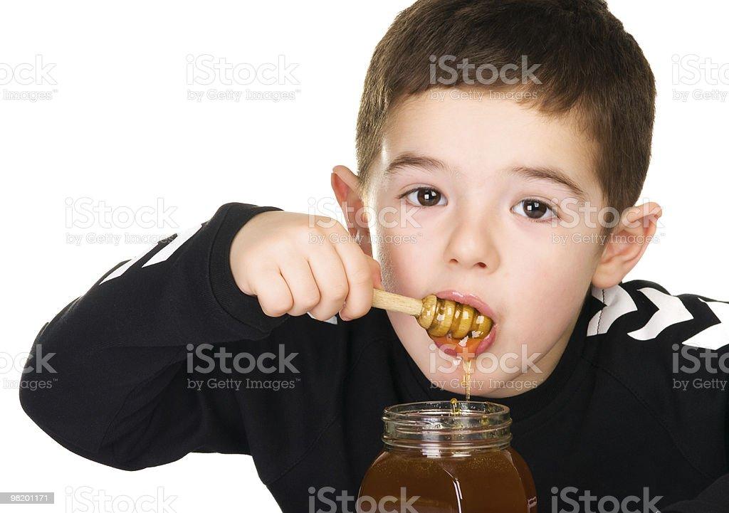 Boy and Honey royalty-free stock photo