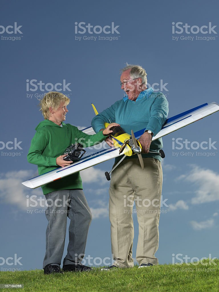 Boy and man with model plane royalty-free stock photo
