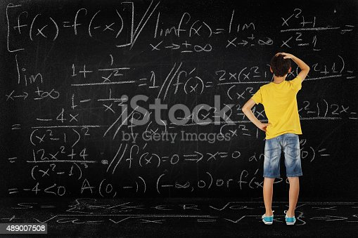 161754253istockphoto boy and maths 489007508