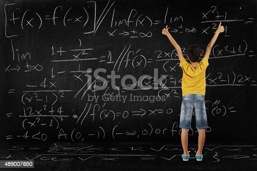 161754253istockphoto boy and maths 489007650