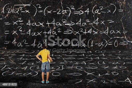 istock boy and maths 489151820