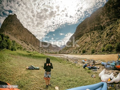Family on a white water rafting trip on the Green River in Dinosaur National Park with beautiful cannons and amazing kayaking on the river with a child