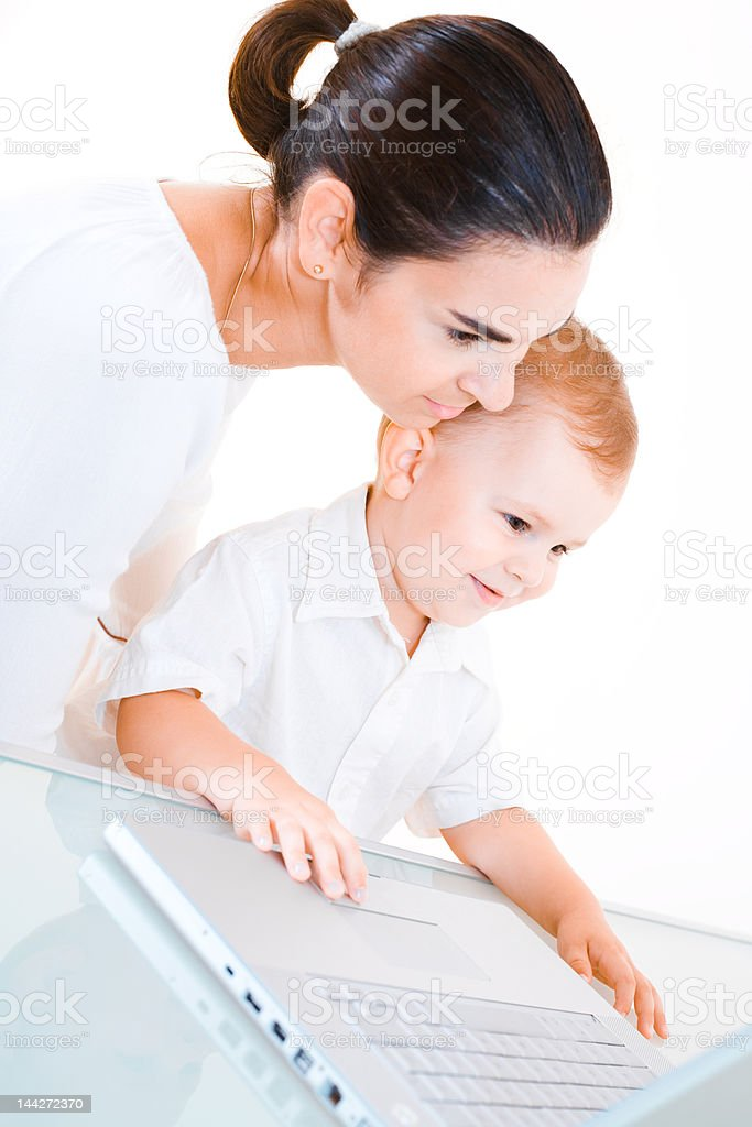 Boy and Mother with laptop royalty-free stock photo