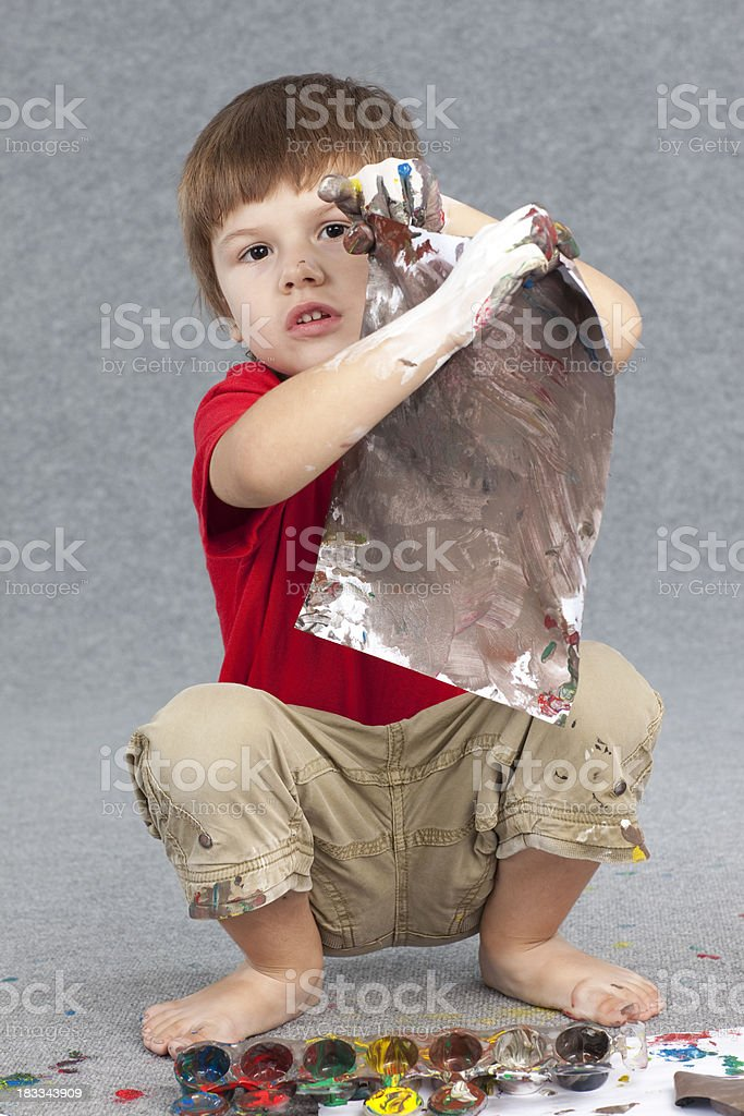 Boy and paints. stock photo