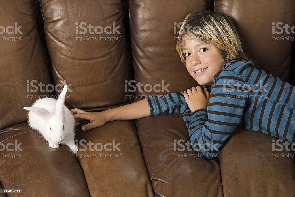 Boy and rabbit 免版稅 stock photo