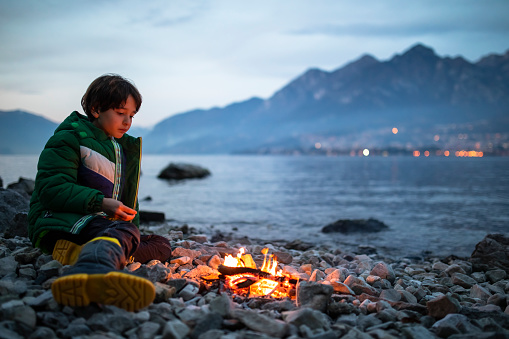 Camping on the shore of the lake with a tent