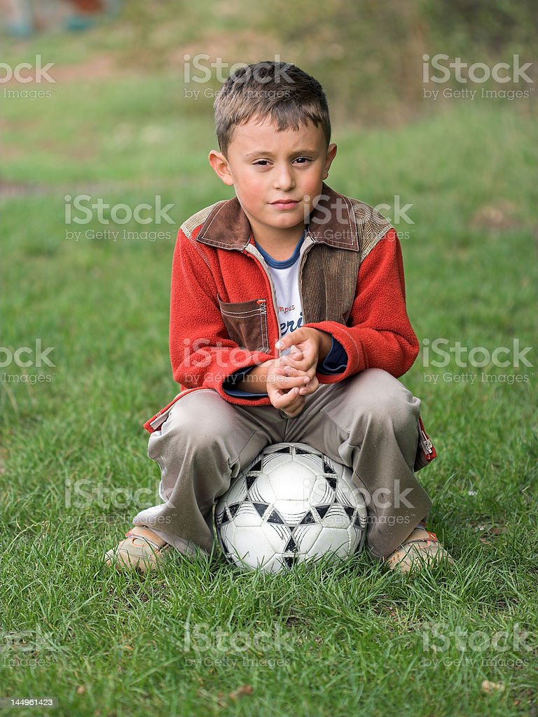 Boy and soccer ball royalty-free stock photo