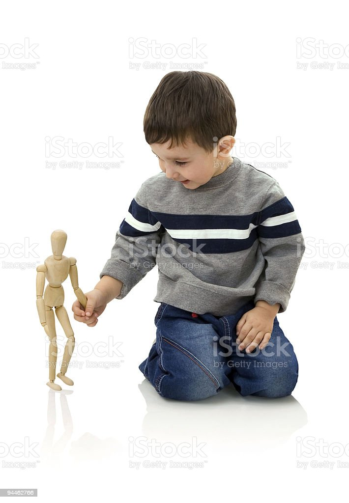 Boy and wooden person royalty-free stock photo