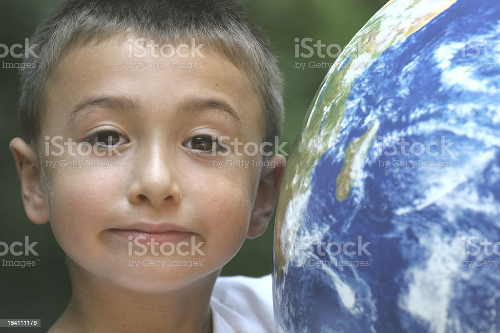 Boy and world stock photo