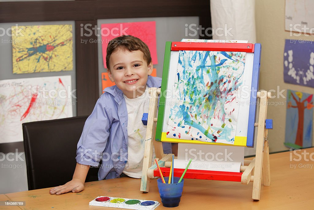 Boy artist with finished painting stock photo